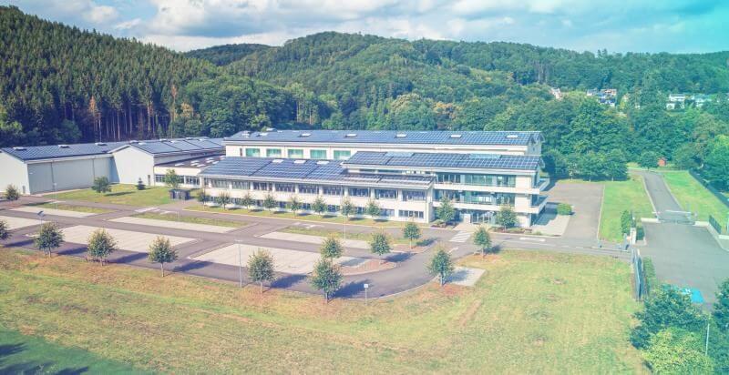 H&K Müller- Außenansicht des Unternehmensgebäudes im Luftbild